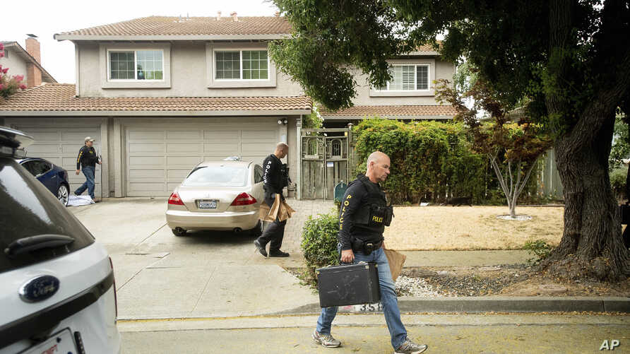 Police officers carry evidence bags from the family home of Gilroy Garlic Festival gunman Santino William Legan, July, 29, 2019, in Gilroy, Calif.