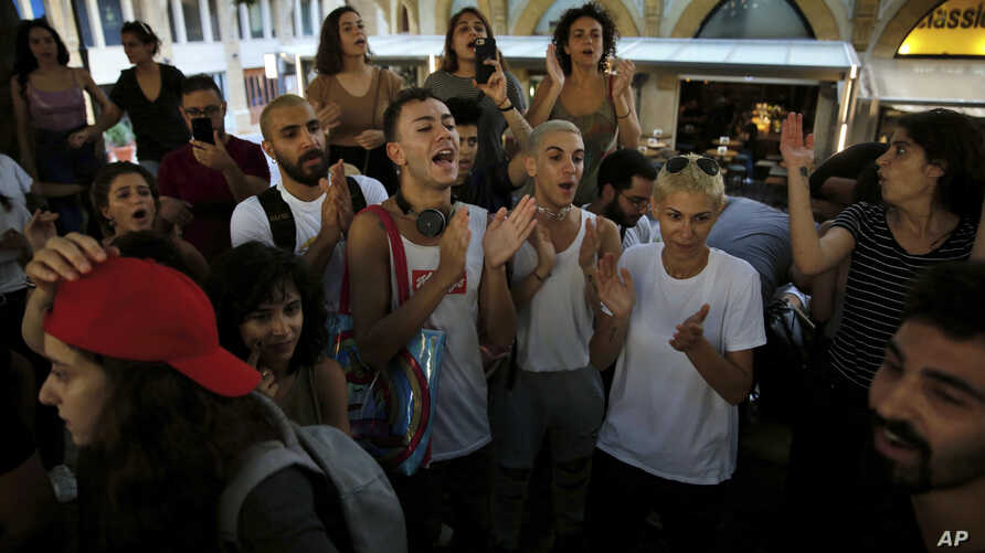 Activists chant slogans during a protest expressing solidarity with Mashrou' Leila or 'Leila's Project' band, a popular rock band known for its rousing music and lyrics challenging norms in the conservative Arab world, Beirut, Lebanon, July 29, 2019.