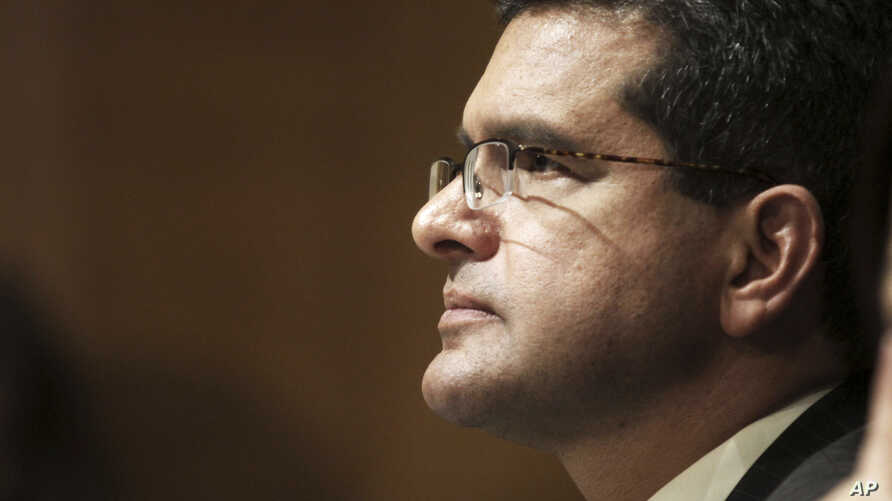 FILE - In this Sept. 29, 2015 file photo, Resident Commissioner Pedro Pierluisi, D-P.R., testifies before the Senate Finance Committee hearing on Puerto Rico's current economic conditions and long-term fiscal health, in Washington.
