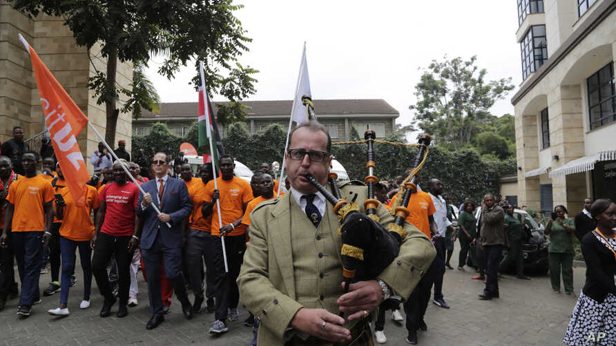 An unidentified man plays the Bagpipes during the reopening of the Dusit D2 hotel in Nairobi, Kenya, July 31, 2019.