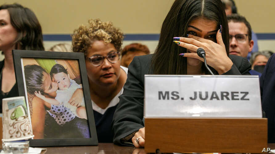 FILE - Yazmin Juárez reacts as a photos of her daughter, Mariee, 1, who died after her released from detention by US Immigration and Customs Enforcement, is placed nearby at a House Oversight subcommittee hearing, Capitol Hill, Washington, July 10, 2019.