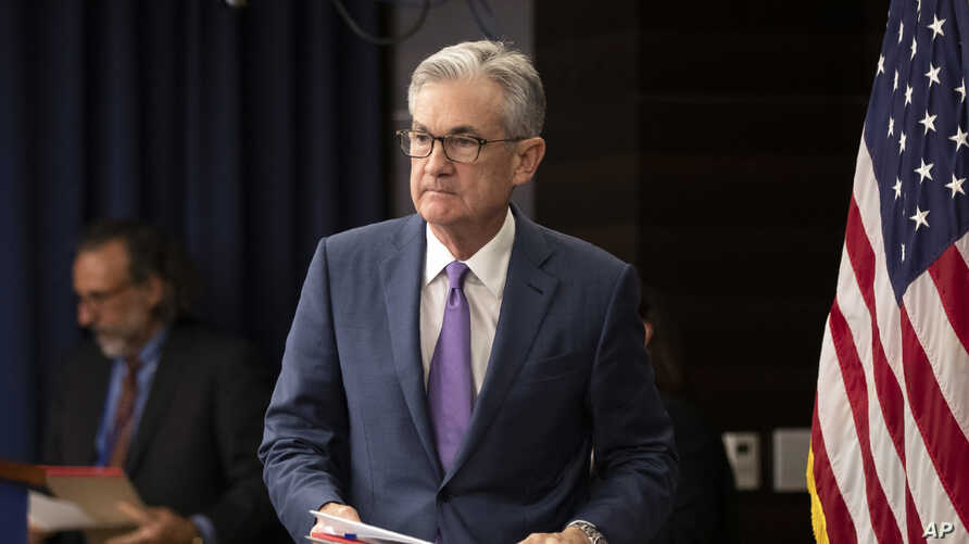 Federal Reserve Chairman Jerome Powell walks to the podium during a news conference in Washington, July 31, 2019.
