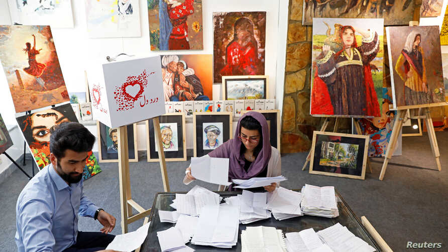 Members of the ArtLords sort letters of Dard-e-Dil (a painful heart) project in Kabul, Afghanistan, July 6, 2019.