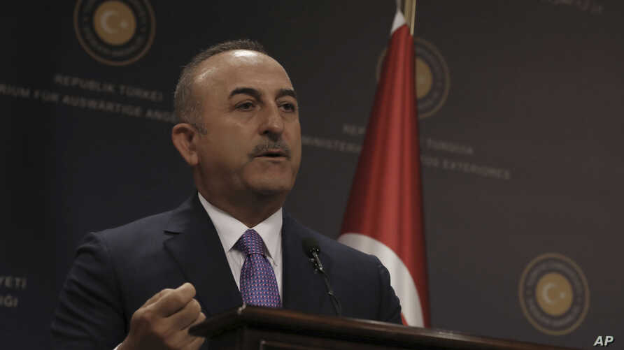 Turkey's Foreign Minister Mevlut Cavugoglu speaks during a news conference in Ankara, Turkey, Wednesday, July 24, 2019.