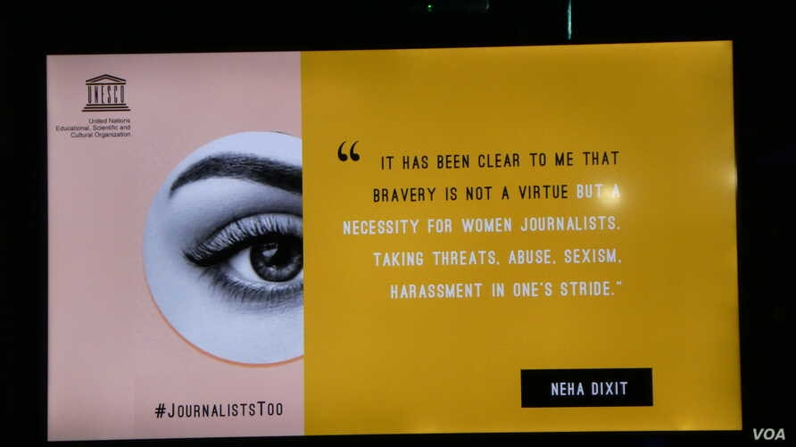 A screen at the Global Conference for Media Freedom shows tweets by female journalists about the dangers they face on the job.