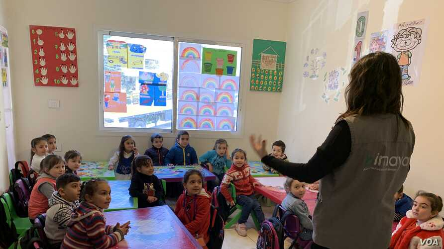 Syrian children are seen in a classroom in Himaya Center, a nongovernmental organization based in Lebanon that works to protect and educate children, mainly girls, and their families of the risks of child marriage. (Nisan Ahmado/VOA)