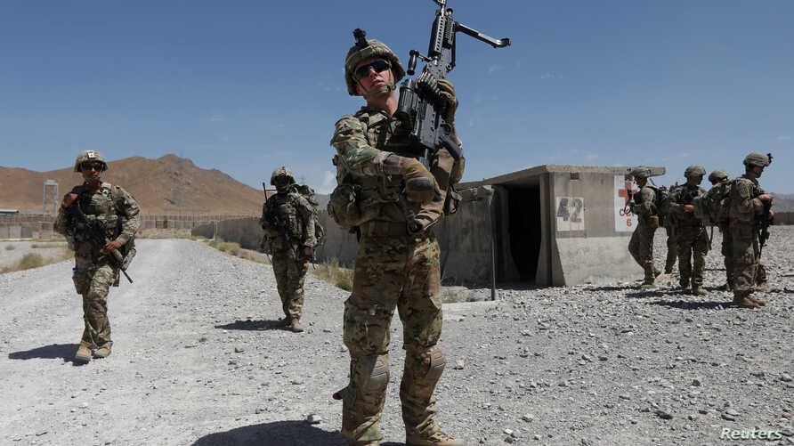 FILE - U.S. troops patrol at an Afghan National Army base in Logar province, Afghanistan Aug. 7, 2018.