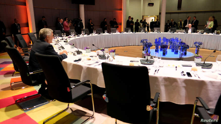 European Parliament President Antonio Tajani and European Commission President Jean-Claude Juncker attend a round table at the European Union leaders summit that aims to select candidates for top EU institution jobs, in Brussels, Belgium, June 30, 2019.