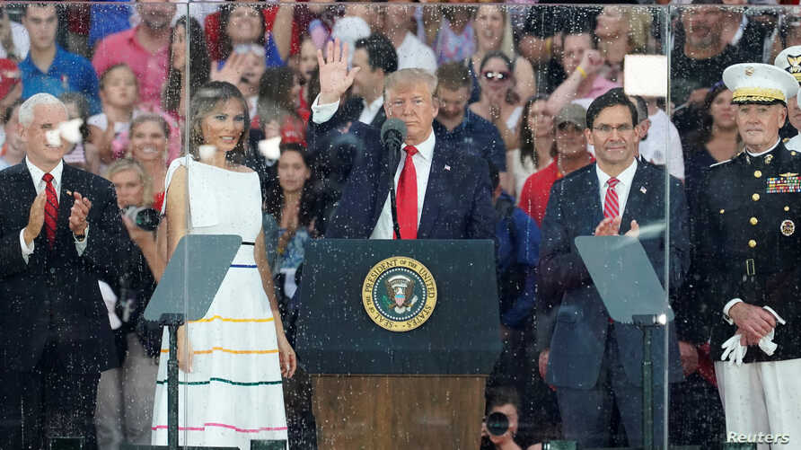 "U.S. President Donald Trump, first lady Melania Trump, Vice President Mike Pence, Acting Secretary of Defense Mark Esper and Chairman of the Joint Chiefs of Staff General Joseph Dunford attend the ""Salute to America"" event in Washington, July 4, 2019."