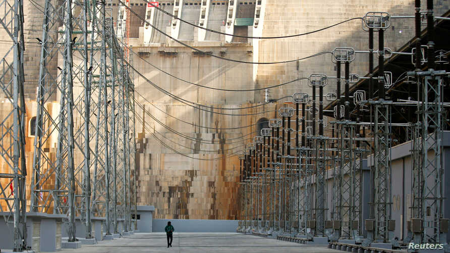 FILE - A man walks within the Gibe III hydroelectric dam during its inauguration in Shoma Yero village in Southern Nations, Nationalities, and Peoples' Region in Ethiopia, Dec. 17, 2016.