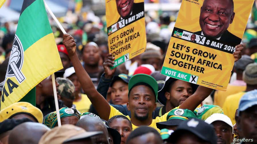 Supporters of President Cyril Ramaphosa's ruling African National Congress celebrate election results at a rally in Johannesburg, South Africa, May 12, 2019.