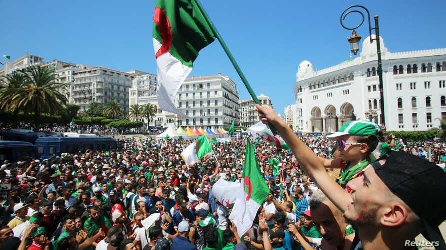 Demonstrators chant slogans during a protest demanding the removal of the ruling elite in Algiers, Algeria, July 19, 2019.