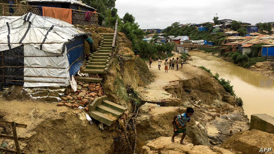 Rohingya children walk around a landslide area at Balukhali refugee camp in Ukhia, Bangladesh, July 7, 2019.
