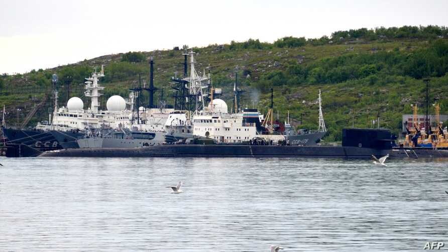 A picture taken July 2, 2019, shows an unidentified submarine in the port of Severomorsk, in Russia.