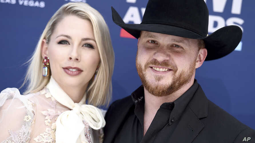 Cody Johnson, right, and Brandi Johnson arrive at the 54th annual Academy of Country Music Awards at the MGM Grand Garden Arena, April 7, 2019, in Las Vegas.