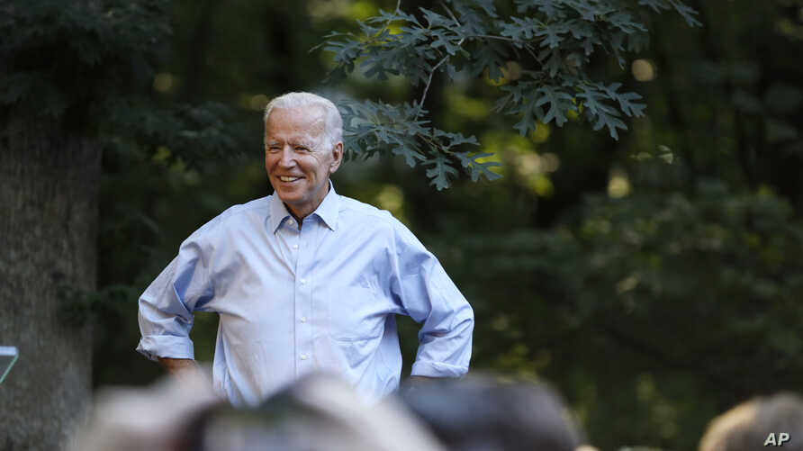 Former Vice President and Democratic presidential candidate Joe Biden arrives to speak at a house party at former Agriculture Secretary Tom Vilsack's house, July 15, 2019, in Waukee, Iowa.