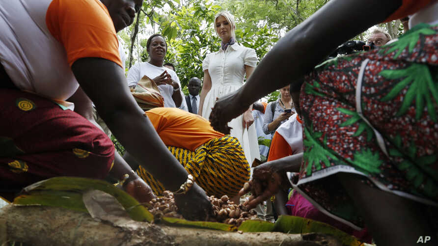 Ivanka Trump, center, watches as women demonstrate how they process cocoa at Cayat, a cocoa and coffee cooperative, April 17, 2019, in Adzope, Ivory Coast.