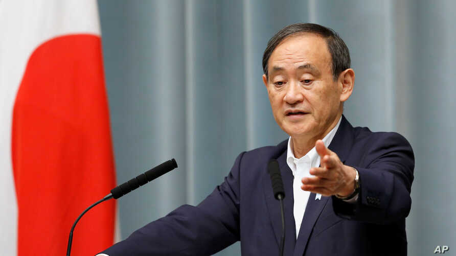 FILE - Japan's Chief Cabinet Secretary Yoshihide Suga attends a news conference at Prime Minister Shinzo Abe's official residence in Tokyo, May 29, 2017.