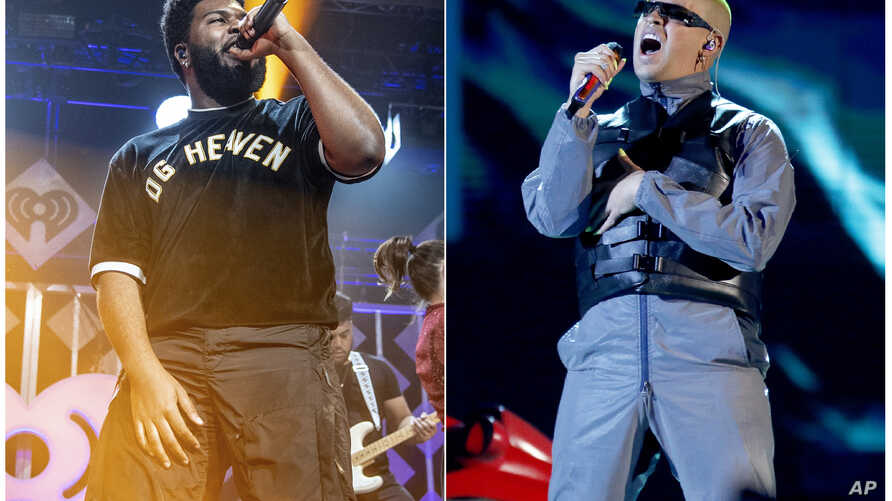 This combination photo shows Khalid performing at Y100's Jingle Ball in Sunrise, Florida, Dec. 16, 2018, left, and Bad Bunny performing at the Billboard Latin Music Awards in Las Vegas, Neveda, April 25, 2019.