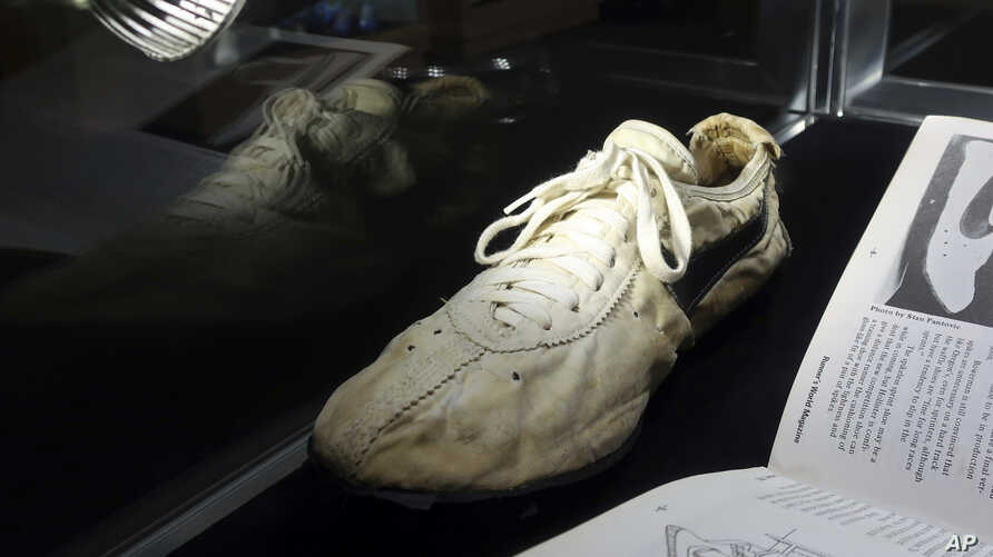 """A Nike """"Moon Shoe"""" is on display at Sotheby's auction house in New York, July 12, 2019."""