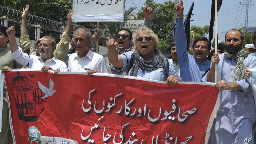 "Pakistani journalists denounce censorship, holding a banner that reads: ""stop sacking journalists,"" in Peshawar, Pakistan, July 16, 2019."