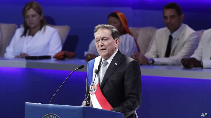 Panama's new President Laurentino Cortizo wears the presidential sash as he speaks during his inauguration ceremony in Panama City, Monday, July 1, 2019.