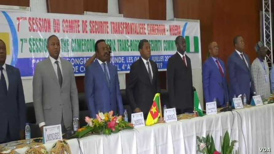 Delegates respect the Cameroon and Nigerian anthem during the Yaounde security meeting in Camerron, July 6, 2019. ( Moki Kindzeka/VOA)