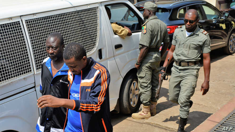 FILE - Men arrested in connection with Cameroon's anglophone crisis are seen at the military court in Yaounde, Cameroon, Dec. 14, 2018. Ten leaders of the separatist movement were sentenced to life in prison Aug. 20, 2019.