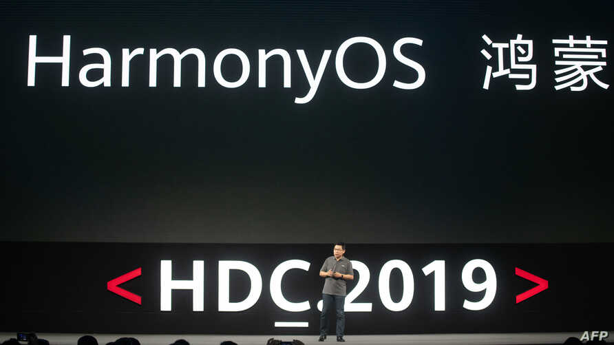 Richard Yu, head of Huawei's consumer business, unveils the company's new HarmonyOS operating system during a press conference in Dongguan, Guangdong province on Aug. 9, 2019.