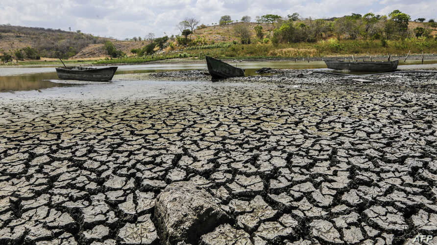FILE - Aground boats are seen at the almost dried lagoon Las Playitas in Ciudad Dario, Matagalpa some 70 km from Managua on March 31, 2016.