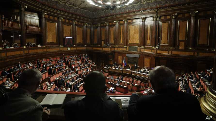 FILE - Italian Premier Giuseppe Conte addresses the Senate in Rome, July 24, 2019.