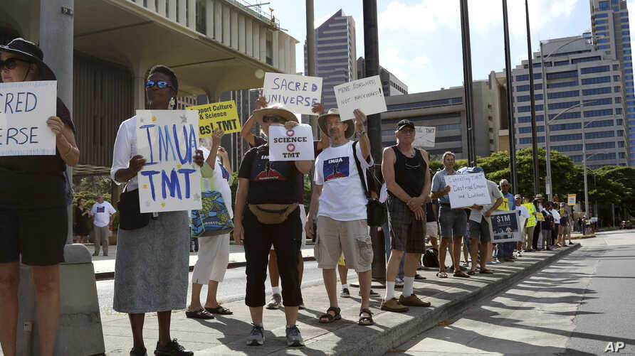 FILE - Supporters of the Thirty Meter Telescope gather for a rally outside the Hawaii State Capitol in Honolulu on Thursday, July 25, 2019.