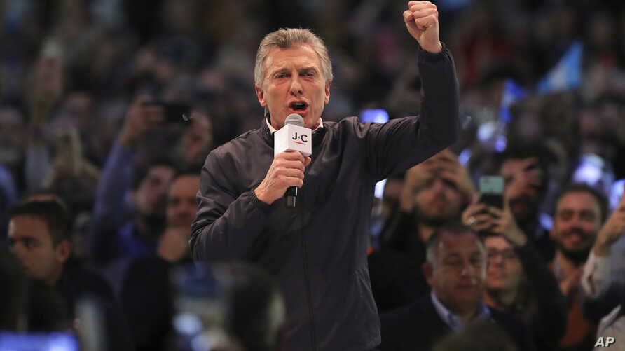 Argentina's President Mauricio Macri works the crowd during a campaign rally  in Cordoba, Argentina, Aug. 7, 2019.