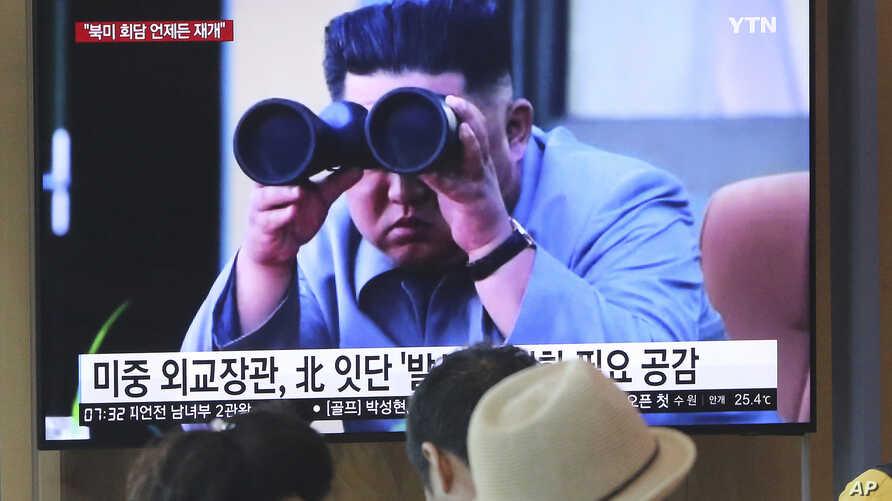 FILE - In this Aug. 2, 2019, file photo, people watch a TV showing a file footage of North Korean leader Kim Jong Un during a news program at the Seoul Railway Station in Seoul, South Korea.