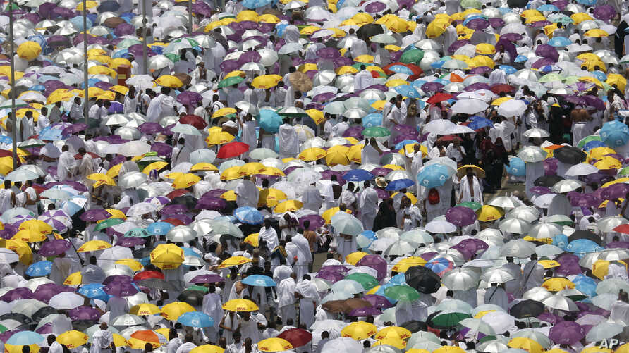 Hundreds of thousands of Muslim pilgrims listen to a sermon outside Namira Mosque in Arafat during the annual hajj pilgrimage, near the holy city of Mecca, Saudi Arabia, Saturday, Aug. 10, 2019.