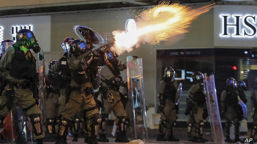 Riot police fire tear gas during the anti-extradition bill protest in Hong Kong, Aug. 11, 2019.