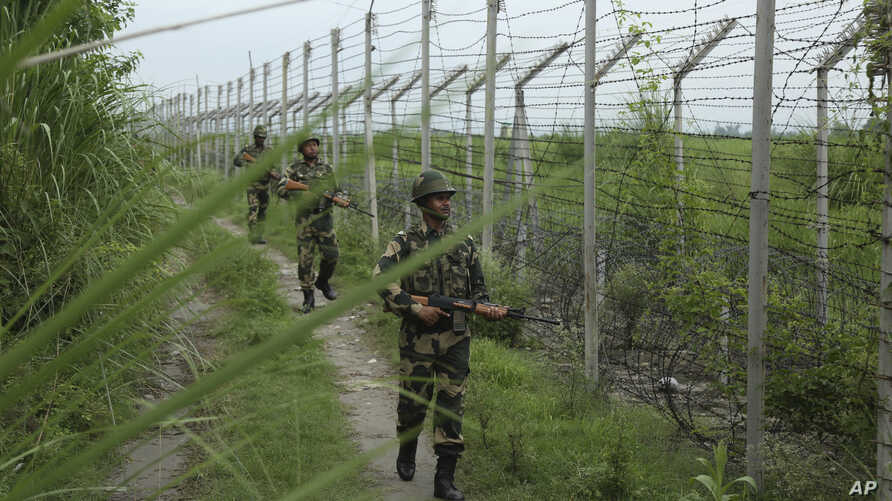 India's Border Security Force soldiers patrol near the India-Pakistan international border fencing at Garkhal in Akhnoor, west of Jammu, India, Aug. 13, 2019.