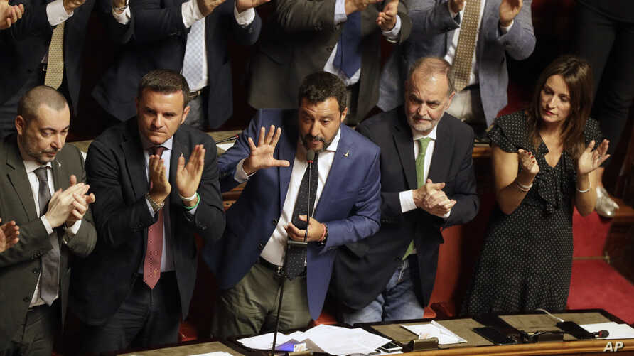 Italian Interior Minister and Deputy-Premier Matteo Salvini is applauded by The League party's lawmakers as he addresses the Senate in Rome,  Aug. 13, 2019.