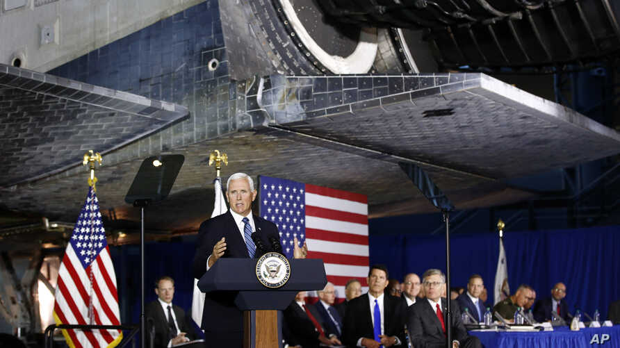 Vice President Mike Pence speaks during the sixth meeting of the National Space Council beneath NASA's Space Shuttle Discovery at the National Air and Space Museum's Steven F. Udvar-Hazy Center in Chantilly, Va., Aug. 20, 2019.