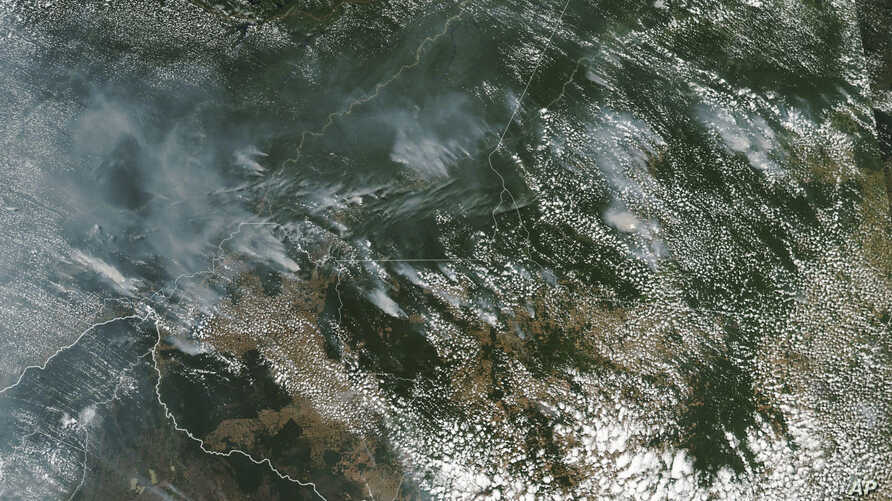 FILE - This satellite image provided by NASA on Aug. 13, 2019, shows several fires burning in the Brazilian Amazon forest.