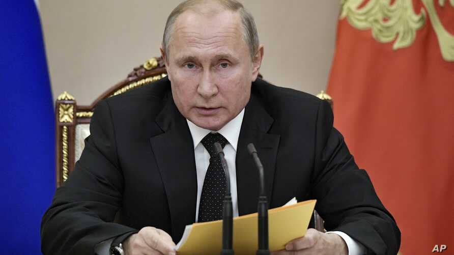 Russian President Vladimir Putin speaks at a meeting with members of the Security Council in the Kremlin in Moscow, Russia.