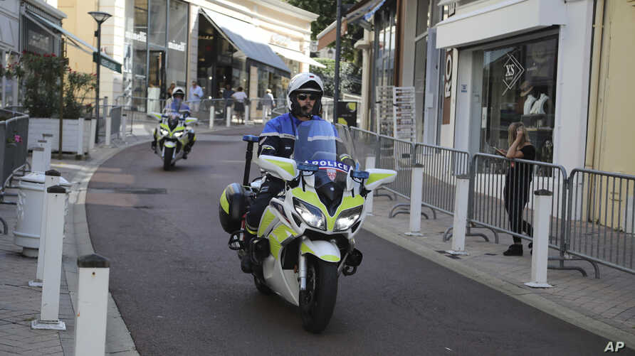 Police officers on motorcycles patrol on deserted streets ahead of the G-7 summit in Biarritz, France, Aug. 23, 2019.