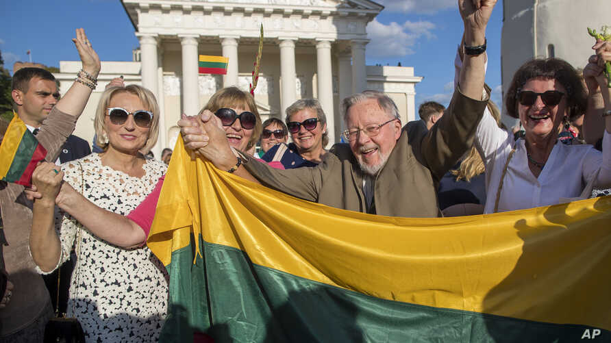 Vytautas Landsbergis, first head of the Lithuania state, is seen with the crowd celebrating 30 years anniversary of the Baltics.