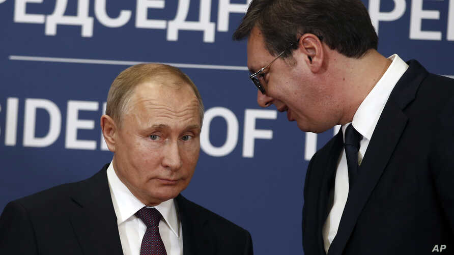 FILE - Russian President Vladimir Putin, left, speaks with Serbian President Aleksandar Vucic during a joint news conference in Belgrade, Serbia, Jan. 17, 2019.