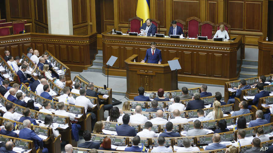 A newly elected Ukraine's prime minister Oleksiy Honcharuk speaks during parliament session in Kyiv, Ukraine, Thursday, Aug. 29, 2019.