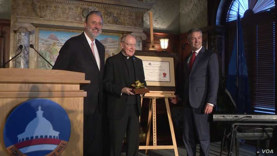 Dutch ambassador Hendrik Jan Jurriaan Schuwer, left, at the 2017 Anne Frank Award ceremony held at the Library of Congress, with Award recipients -- the Reverand Leo J. O'Donovan, center, on behalf of the Jesuit Refugee Service (JRS), and Robert Quinn, founding executive director of Scholars at Risk