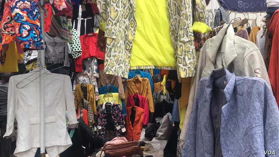 This shop in Nairobi's Toi market sells imported, inexpensive used clothing. (M. Yusuf/VOA)