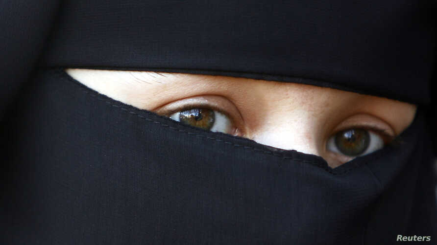 FILE - A protestor attends a demonstration against the ban on Muslim women wearing the burqa in public in The Hague, Netherlands.