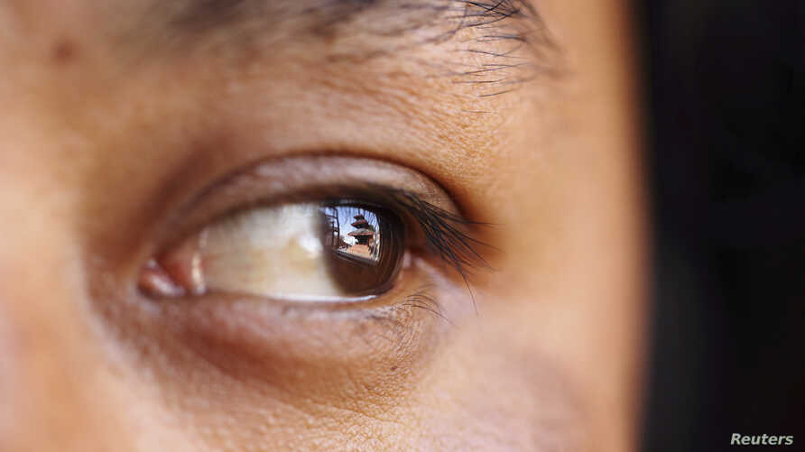 FILE - Researchers have found that tracking eye movement can reveal when a person recognizes another.