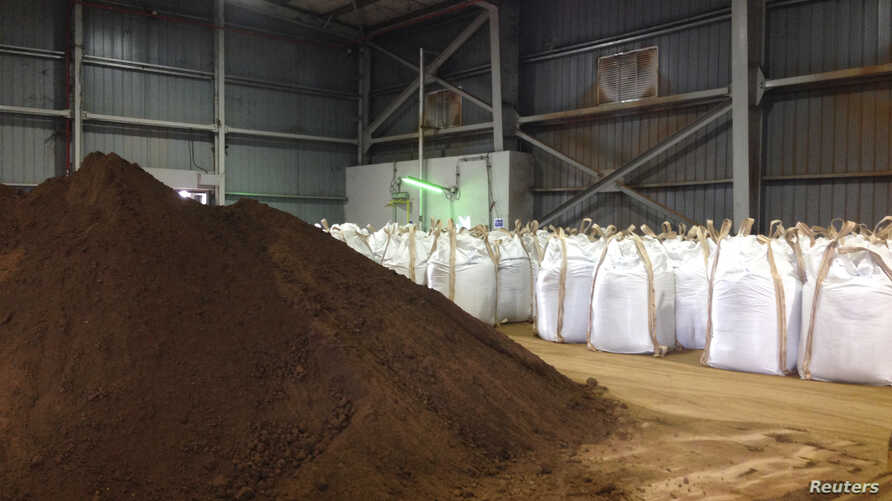 FILE - Rare earths dug up and processed into concentrate at Mount Weld in western Australia, are pictured after being shipped to a plant in Gebeng, Malaysia, July 3, 2014.